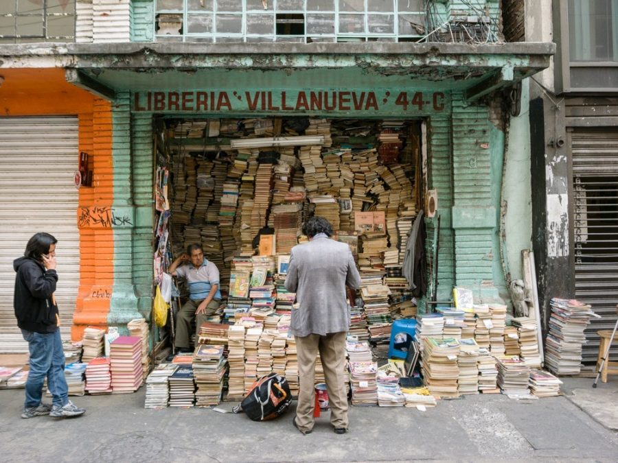 "While skating in Mexico City I came across this ""bookstore."" It's so sick. Look at the chaos of books inside this place, who knows how deep it goes, which really doesn't matter because you can only really reach the books you can see. And the way they're piled up you can't even see the spine of any of them, so how do you even know what each book is? Maybe the guy inside the store there knows."